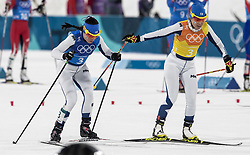 February 17, 2018 - Pyeongchang, South Korea - Riitta-Liisa ROPONEN, right, tags Krista PARMAKOSKI of Finland in the final laps during the action in the Ladies' 4 x 5km Relay at the Alpensia Cross-Country Center during the 2018 Pyeongchang Winter Olympic Games. (Credit Image: © Daniel A. Anderson via ZUMA Wire)