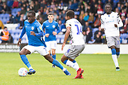 Macclesfield Town forward Arthur Gnahoua in action during the EFL Sky Bet League 2 match between Macclesfield Town and Colchester United at Moss Rose, Macclesfield, United Kingdom on 28 September 2019.