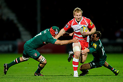 Gloucester Flanker (#7) Matt Kvesic is tackled by Leicester Flanker (#7) Julian Salvi and Leicester Outside Centre (#13) Adam Thompstone during the first half of the match - Photo mandatory by-line: Rogan Thomson/JMP - Tel: Mobile: 07966 386802 - 29/11/2013 - SPORT - RUGBY UNION - Kingsholm Stadium, Gloucester - Gloucester Rugby v Leicester Tigers - Aviva Premiership.