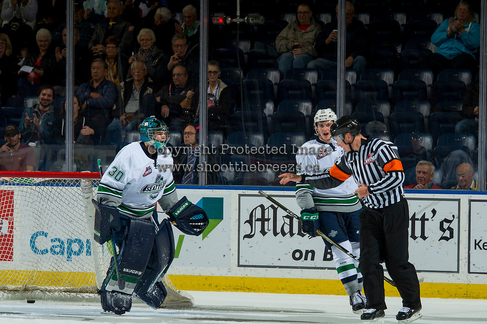 KELOWNA, CANADA - OCTOBER 10: Liam Hughes #30 of the Seattle Thunderbirds challenges a goal by the Kelowna Rockets called by referee Ward Pateman on October 10, 2018 at Prospera Place in Kelowna, British Columbia, Canada.  (Photo by Marissa Baecker/Shoot the Breeze)  *** Local Caption ***