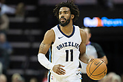 MEMPHIS, TN - OCTOBER 30:  Mike Conley #11 of the Memphis Grizzlies dribbles the ball down the court during a game against the Charlotte Hornets at the FedEx Forum on October 30, 2017 in Memphis, Tennessee.  NOTE TO USER: User expressly acknowledges and agrees that, by downloading and or using this photograph, User is consenting to the terms and conditions of the Getty Images License Agreement.  The Hornets defeated the Grizzlies 104-99.  (Photo by Wesley Hitt/Getty Images) *** Local Caption *** Mike Conley