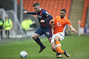 Bradford City striker Shay McCartan (14) and Blackpool midfielder Colin Daniel (23) during the EFL Sky Bet League 1 match between Blackpool and Bradford City at Bloomfield Road, Blackpool, England on 7 April 2018. Picture by Craig Galloway.