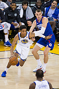 Golden State Warriors guard Patrick McCaw (0) drives to the basket against the LA Clippers at Oracle Arena in Oakland, Calif., on January 10, 2018. (Stan Olszewski/Special to S.F. Examiner)