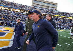 Nov 10, 2018; Morgantown, WV, USA; West Virginia Mountaineers head coach Dana Holgorsen runs off the field after beating the TCU Horned Frogs at Mountaineer Field at Milan Puskar Stadium. Mandatory Credit: Ben Queen-USA TODAY Sports
