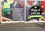 East of England Co-operative Society shop advertising boards hoardings, Woodbridge, Suffolk, UK