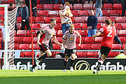 Sunderland's Paddy McNair scores a goal and celebrates 1-0  during the EFL Sky Bet Championship match between Sunderland and Burton Albion at the Stadium Of Light, Sunderland, England on 21 April 2018. Picture by John Potts.