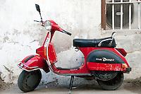 A red motor scooter in Zanzibar, Tanzania