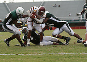 Bethune-Cookman quarterback Jimmie Russell (10) runs for this short gain against Norfolk State during their 63-61 four overtime win at Dick Price Stadium in Norfolk, Virginia.  September 24, 2005  (Photo by Mark W. Sutton)