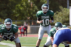 17 September 2011: Jeremy Adams watches the defensive line up as quarterback Rob Gallik readies to recieve the hike in the shotgun during an NCAA Division 3 football game between the Aurora Spartans and the Illinois Wesleyan Titans on Wilder Field inside Tucci Stadium in.Bloomington Illinois.