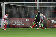 Ryan Watson scores and celebrates the opening goal   during the EFL Sky Bet League 2 match between Cheltenham Town and Northampton Town at Jonny Rocks Stadium, Cheltenham, England on 25 February 2020.