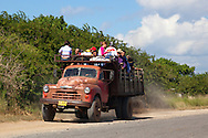 Old truck hauling a load of people in Pinar del Rio, Cuba.