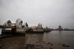 © Licensed to London News Pictures. 05/12/2013. London, United Kingdom. The Thames Barrier as seen during a cloudy morning today. The Barriers are to be lowered this evening (5th December 2013) due to expected storm surges following high winds across the country. Photo credit : Andrea Baldo/LNP