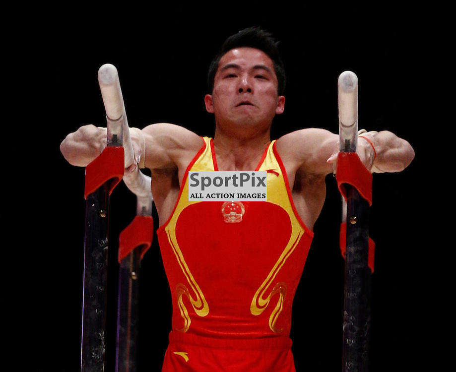 2015 Artistic Gymnastics World Championships being held in Glasgow from 23rd October to 1st November 2015.....Shudi Deng (Peoples Republic of China) performs on the Parallel Bars on Day 2 of the Women's & Men's Apparatus Final...(c) STEPHEN LAWSON | SportPix.org.uk