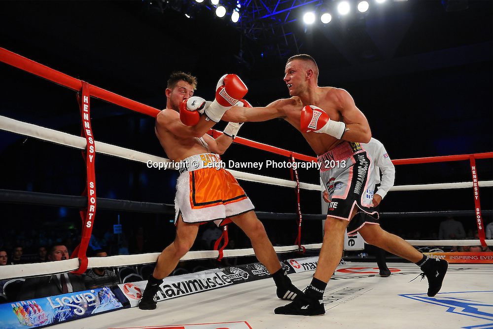 Chris Jenkinson lands a right on Adam Battle during their Light Middleweight contest. Glow, Bluewater, Kent, UK. Hennessy Sports © Leigh Dawney Photography 2013.