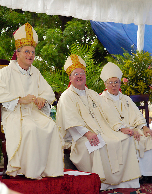 Bishop Timothy Broglio, left, Archbishop Timothy M. Dolan and Bishop Richard J. Sklba listen to Bishop Jose Grullon speak at a Mass Oct. 29.