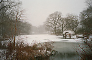 The Lake and Wagner Cove gazebo during a snow storm in Central Park, New York City