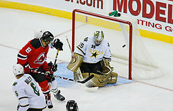 Oct 22, 2008; Newark, NJ, USA; Dallas Stars goalie Marty Turco (35) makes a save on a shot by New Jersey Devils center Dainius Zubrus (8) during the second period at the Prudential Center.