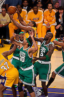 17 June 2010: Center Andrew Bynum of the Los Angeles Lakers grabs a rebound against the Boston Celtics during the first half of the Lakers 83-79 championship victory over the Celtics in Game 7 of the NBA Finals at the STAPLES Center in Los Angeles, CA.