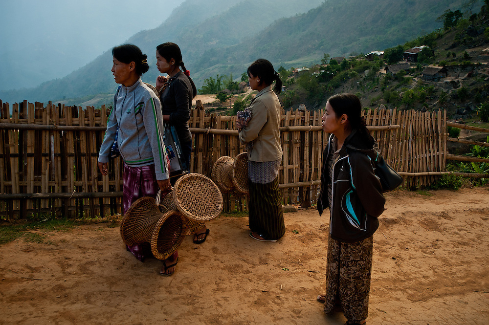 Naga women carry hand-woven stools to the village of Layshee, where they'll be sold to traders who will take them to the Chindwin River for transport to Yangon.