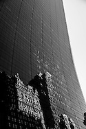 New York, Solow Building on 58 street. mirror game and skyscrapers reflection.