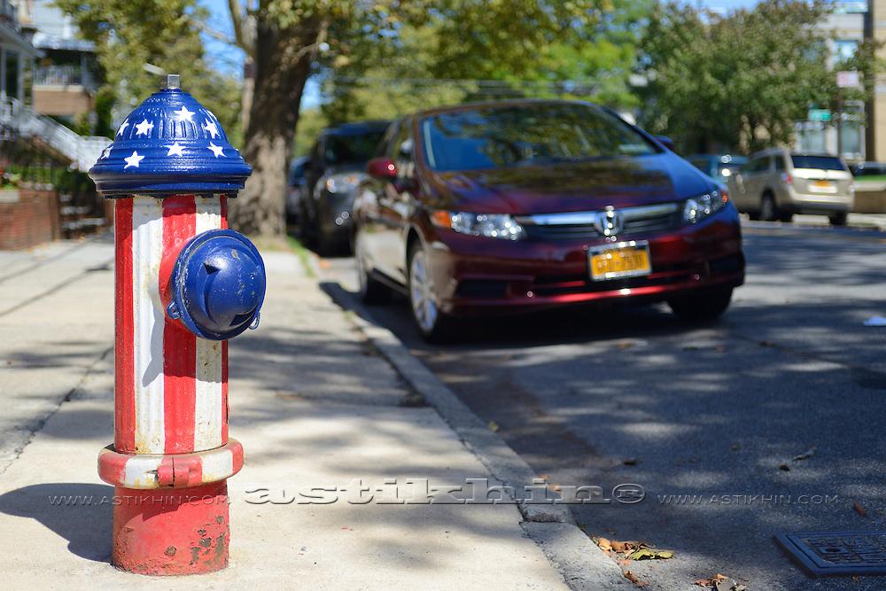 Hydrant with American Flag on street of Brooklyn NYC.