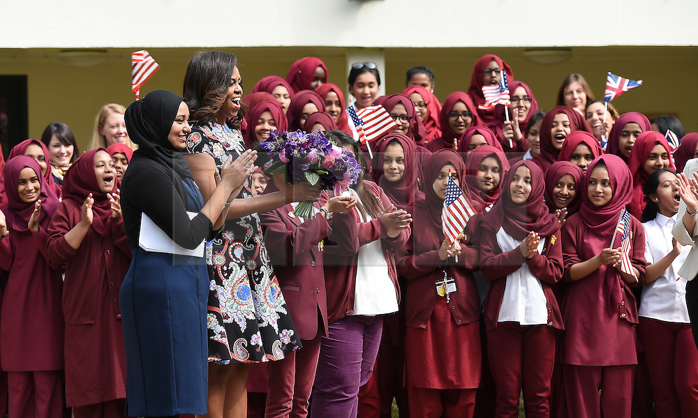 © Licensed to London News Pictures. 16/06/2015. London, UK. First lady MICHELLE OBAMA is greeted by students as she arrives for a visit to Mulbery School For Girls in east London. Photo credit: Ben Cawthra/LNP