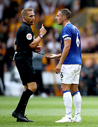 Referee Craig Pawson shows a red card to Everton's Phil Jagielka after a tackle on Wolverhampton Wanderers' Diogo Jota (not in picture) during the Premier League match at Molineux, Wolverhampton.