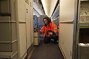 Nesrine performs a servere conrol of a plane.  At Roissy, Nesrine, 34, works as a technical inspector  for the DGCA (Directorate General of Civil Aviation) - she is the only female technical controller at the airport of Roissy-en-France. She can stop a Boeing taking off and make the 300 passengers leave the airplane. Nesrine Chkioua is the only woman controller at Roissy Airport and one of three women doing this job in France.<br /> <br /> <br /> &Agrave; Roissy, Nesrine, 34 ans, exerce le m&eacute;tier de contr&ocirc;leur technique (CTE) pour la DGAC (Direction g&eacute;n&eacute;rale de l&rsquo;aviation civile) - elle est la seule femme contr&ocirc;leur technique &agrave; l&rsquo;a&eacute;roport de Roissy-en-France.  Elle peut immobiliser un Boeing, retarder le d&eacute;collage et m&ecirc;me faire d&eacute;barquer les 300 passagers d&rsquo;un long-courrier. Nesrine Chkioua est la seule contr&ocirc;leur femme &agrave; Roissy a&eacute;roport et est une des trois femmes &agrave; exercer ce m&eacute;tier en France.