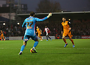 Button amd graham during the Sky Bet Championship match between Brentford and Wolverhampton Wanderers at Griffin Park, London, England on 29 November 2014.