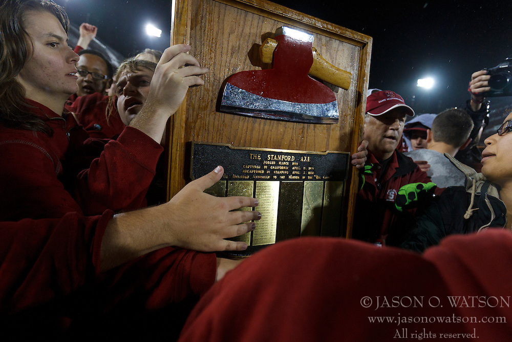 Nov 19, 2011; Stanford CA, USA;  Stanford Cardinal students carry the Stanford axe off the field after the game against the California Golden Bears at Stanford Stadium.  Stanford defeated California 31-28. Mandatory Credit: Jason O. Watson-US PRESSWIRE