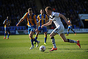 Sam Kelly of Port Vale FC sprints clear of Shaun Whalley of Shrewsbury Town during the Sky Bet League 1 match between Shrewsbury Town and Port Vale at Greenhous Meadow, Shrewsbury, England on 25 March 2016. Photo by Mike Sheridan.