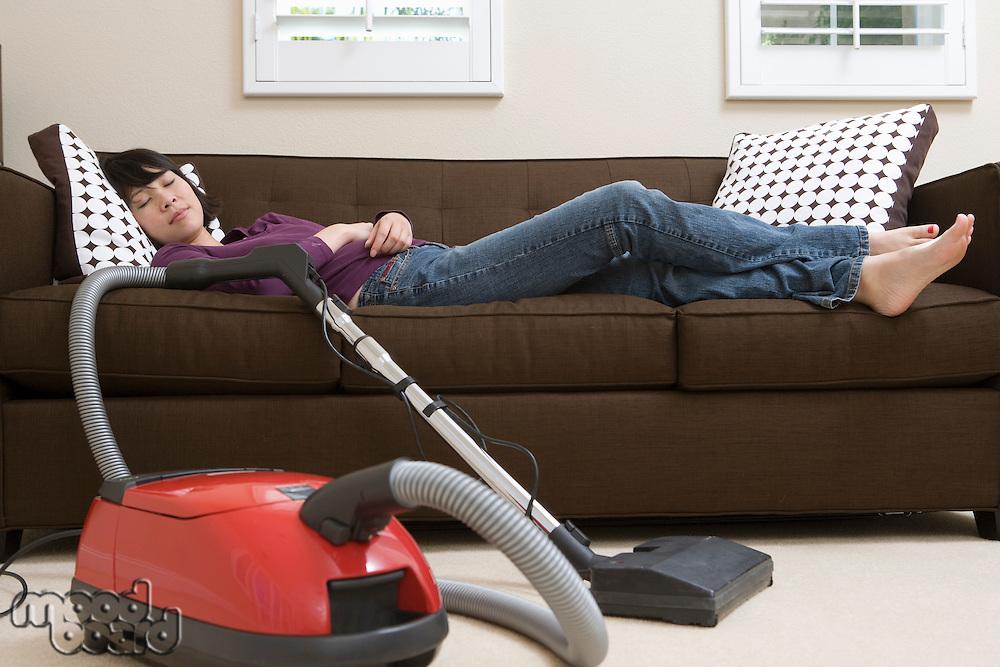 Woman sleeping after vacuuming