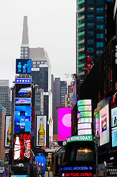 Lights coming up in Times Square in New York City