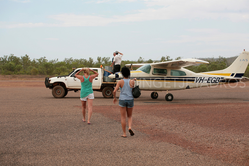 Tourists boarding a plane for a scenic flight (Broome) Published in Korean Air Inflight Magazine 'Morning Calm', April 2013