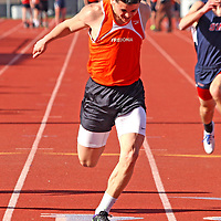 Fredonia's  Jovany Ruiz crosses the finishline en route to winning the 100 meter dash 4-20-16 photo by Mark L Anderson