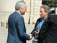 """Michel Drucker welcomed by the Deputy Prime Minister Didier Reynders for the title of Commander of the Order of the Crowne at the Palace Egmont"""" at Brussels, 2014 in Brussels, Belgium."""