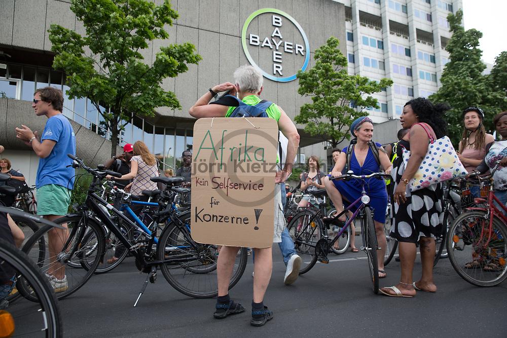 Berlin, Germany - 09.06.2017<br /> <br /> Protest stop in front of the Bayer company site. &rdquo;Visitez les profiteurs&quot; bike rally against the upcoming G20-Africa conference.<br /> <br /> Protestkundgebung vor dem Bayer-Firmengelaende.&rdquo;Visitez les profiteurs&rdquo; Fahrrad Demonstration gegen die bevorstehende G20-Afrika Konferenz.<br /> <br /> Photo: Bjoern Kietzmann