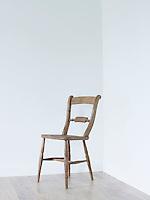 Wooden chair in empty room corner