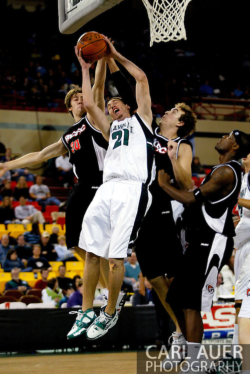 11/25/2006 - Anchorage, Alaska: Senior guard Matt Lojeski (21) of the Hawaii Warriors gets fouled as he heads to the hoop from the baseline as Hawaii beat Pacific 71-60 to give the Warriors a third place finish in the 2006 Great Alaska Shootout<br />