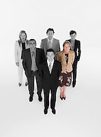 Ambitious businessman with team of professionals against white background