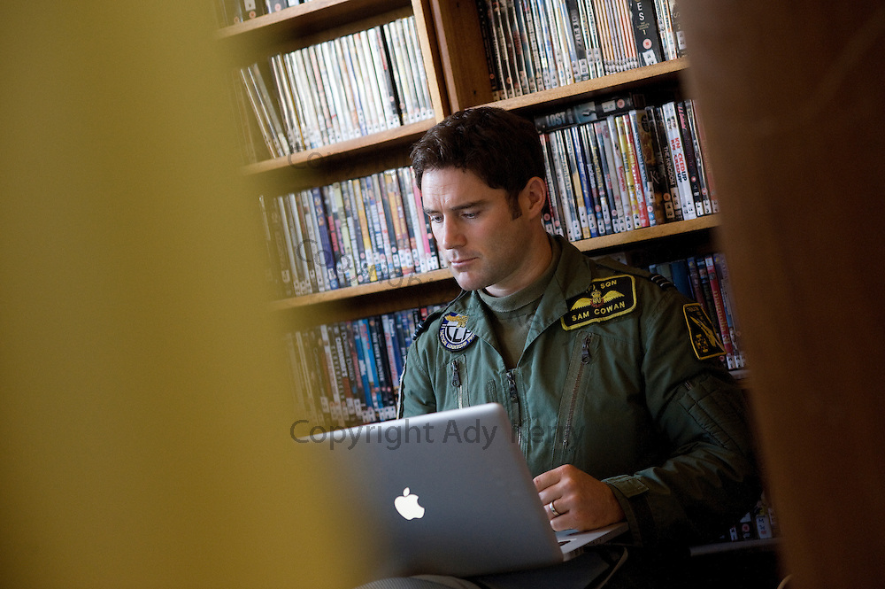 Flt Lt Sam Cowan catches up with work whilst waiting for a shout on one of the last days of QRA duty for Tornado F3 crews.  The Tornado is being retired and replaced with Typhoon, 16th September 2009.