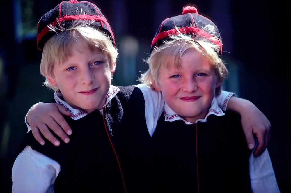 Two Swedish brothers in native costume, celebrating Midsummer in Siljansnas, Dalarna Province, Sweden,