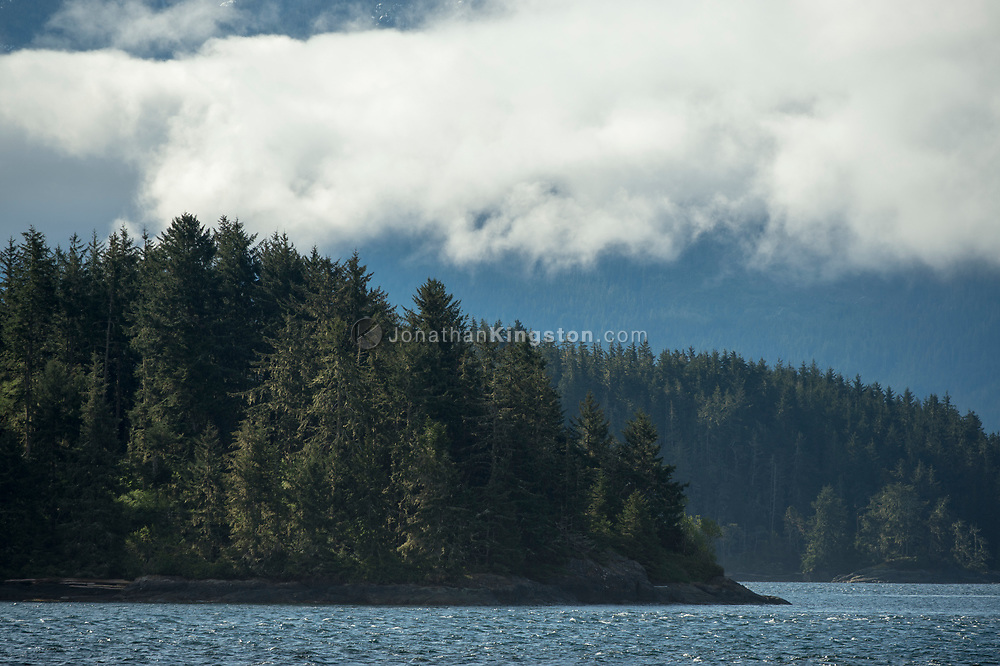 Low clouds hover over mountains on the Inside Passage, BC.