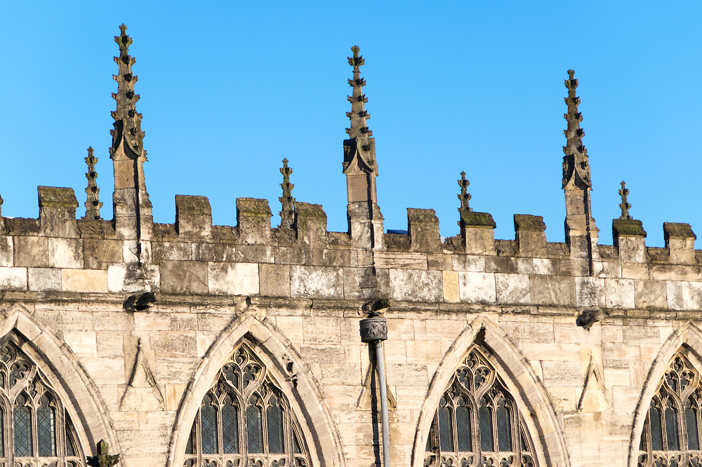 15th century crenellations with interspersing cusped pinnacles at Saint Mary Beverley