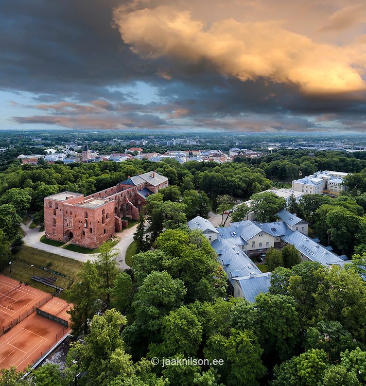 Stormy clouds over old Tartu downtown in Estonia. Aerial, Toomemägi, ruins of Dome church.