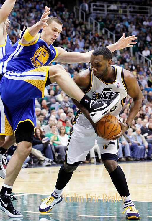 Golden State Warriors center Andris Biedrins of Latvia (15) fouls Utah Jazz center Al Jefferson (25) during the second half of an NBA basketball game, Friday, April 6, 2012, in Salt Lake City.  Jefferson Scored 30-points in Utah's 104-98 win. (AP Photo/Colin E Braley).