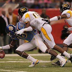 2008 November, 29: Grambling State safety T.J. McCord (16) forces a fumble by Southern University wide receiver Charles Booker (89) during the first half of the 35th annual State Farm Bayou Classic between Southern University and Grambling State University at the Louisiana Superdome in New Orleans, LA.  .