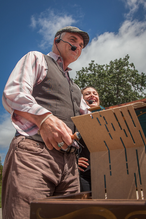 """Master of Ceremony with the Cirque de Boheme, Michel Michelis and his sister Arabella, perform """"Songs of Paris"""" while playing a 1908 Barrel Organ at the Farmer's Market in Pleasant Hill, California  """"Performing is my life!"""""""