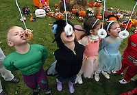 Gloucester: Children at Majestic Harbor Community School try to eat donuts hanging from strings without using their hands Friday morning. The Gibbs Street pre-school held a Halloween party for the children with costumes, pumpkin decorating and a few donuts. From left are Max Howlett, Kristiana Springer, Vanessa Muise-Pavia, and Jillian Gibbs. .Photo by Mike Dean/Gloucester Daily Times Friday, October 28, 2005