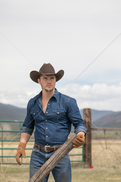 sexy masculine cowboy working on a ranch